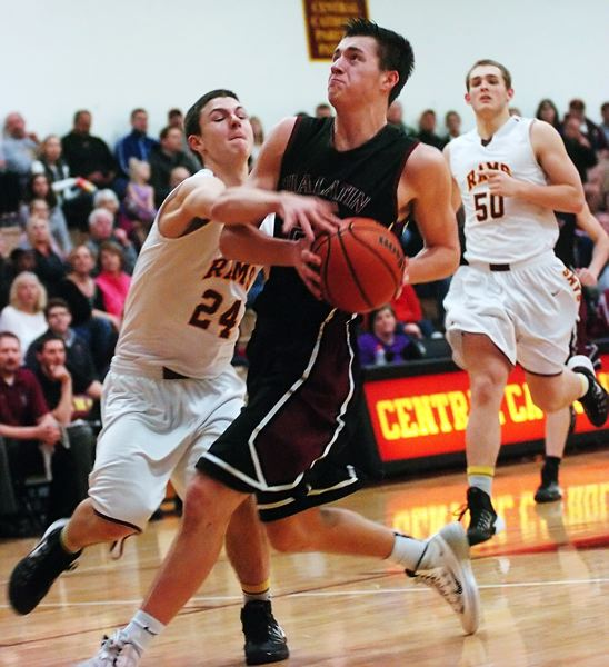 by: DAN BROOD - HACKED -- Tualatin junior Steven Shockloss is fouled by Central Catholic sophomore Ben College as he goes to the basket in Wednesday's state playoff game.