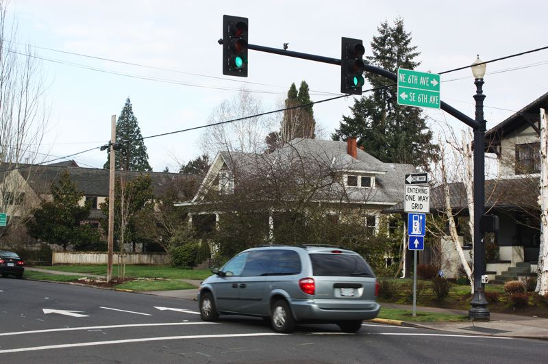 by: HILLSBORO TRIBUNE PHOTO: DOUG BURKHARDT - Motorists might not have to navigate around the downtown areas many one-way streets, including this one at the corner of Sixth Avenue and Main Street, if the Hillsboro City Council decides to change the citys traffic grid. A proposal before the council could result in most of these sometimes confusing one-way signs coming down.