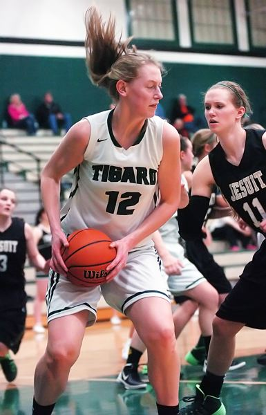 by: DAN BROOD - CLEANING THE GLASS -- Tigard sophomore post Elise Conroy pulls down a rebound in front of Jesuit's Lauren Click.
