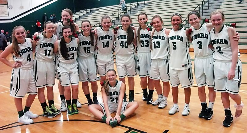 by: DAN BROOD - TOURNAMENT TEAM -- The Tigard High School girls basketball team is moving on to the Class 6A state tournament. Pictured are, from left, Megan Priaulx, Hannah Armstead, Elise Conroy (top), Melissa Keenan, Jessie King, Ashley Holzgang, Kylie Warren (sitting), Natalie Clark, Stephanie King, Faithe Wantland, Lexi Carter, Emilee Cincotta and Kaylie Boschma.