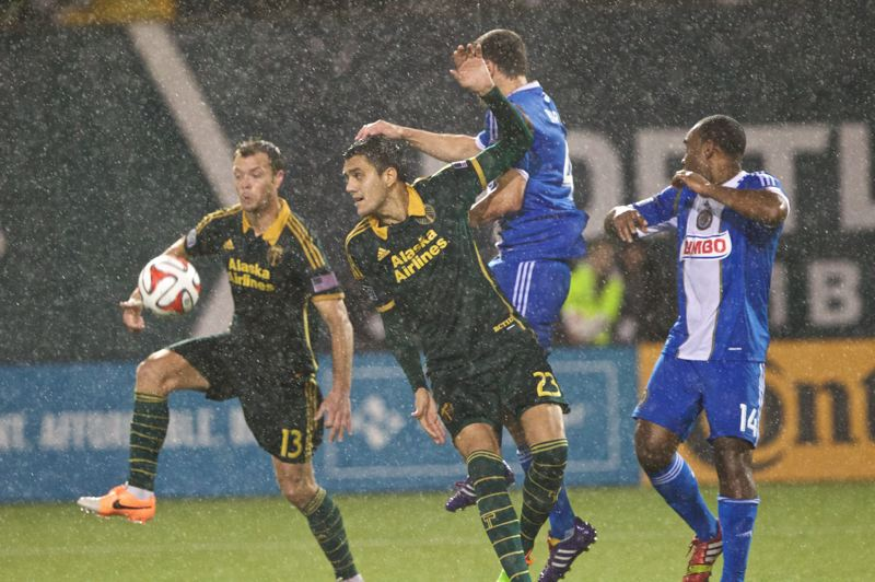 by: TRIBUNE PHOTO: JAIME VALDEZ - Timbers midfielder Jack Jewsbury (left) and defender Norberto Paparatto go for a loose ball against Philadelphia.