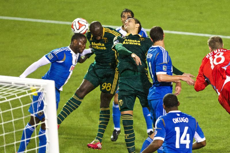 by: TRIBUNE PHOTO: JAIME VALDEZ - Timbers defender Mamadou Danso (98) and Timbers midfielder Maximiliano Urruti (37) go up for a header.