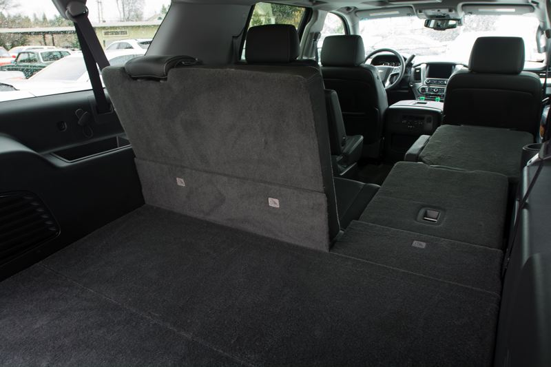 by: JOHN M. VINCENT - Both the second and third row of seats in the 2015 Suburban fold flat for the first time. You no longer have to remove the third row to have a flat load floor.