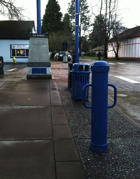 by: SPOKESMAN PHOTO: JOSH KULLA - Bike stands, rubbish bins, street signs, light poles and more; theyre all blue in downtown Sherwood, part of the citys way finding program.
