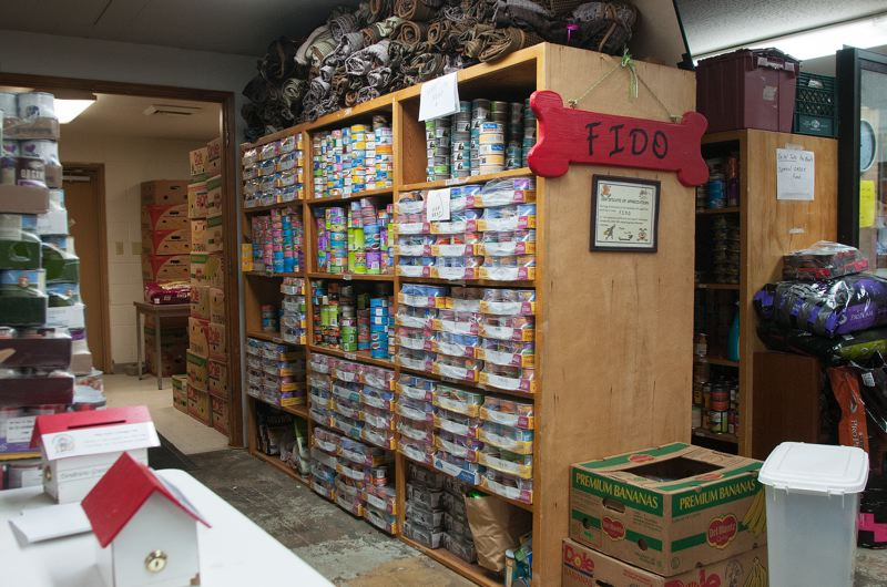 by: SPOKESMAN PHOTO: JOSH KULLA - The FIDO dog food bank, located on the countys Red Soils Campus in Oregon City, is the main storage space for AniMeals resources in Clackamas County.