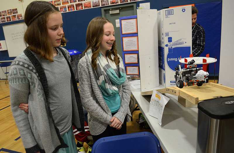 by: PAMPLIN MEDIA GROUP: VERN UYETAKE - Kelsey Bjorklund, left, and Riley Badnin built a robot to pick up and dispose litter. Both girls are sixth-graders at Rosemont Ridge Middle School.