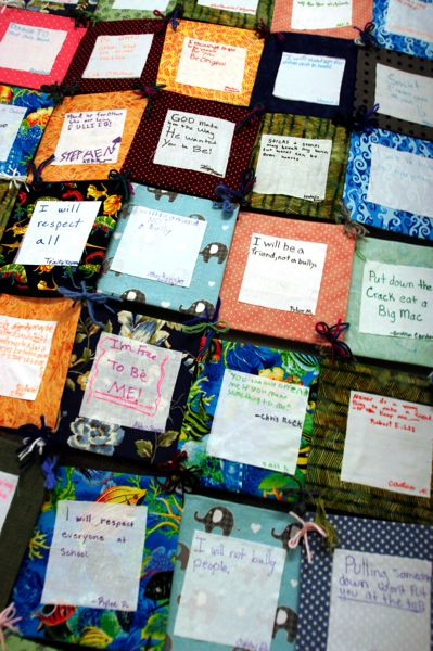 by: OUTLOOK PHOTO: JIM CLARK - For their quilt project, students glued fabric swaths to cardboard and wrote statements about bullying. After assembling the quilt last fall, students displayed it in their cafeteria as a daily reminder of their pledges.