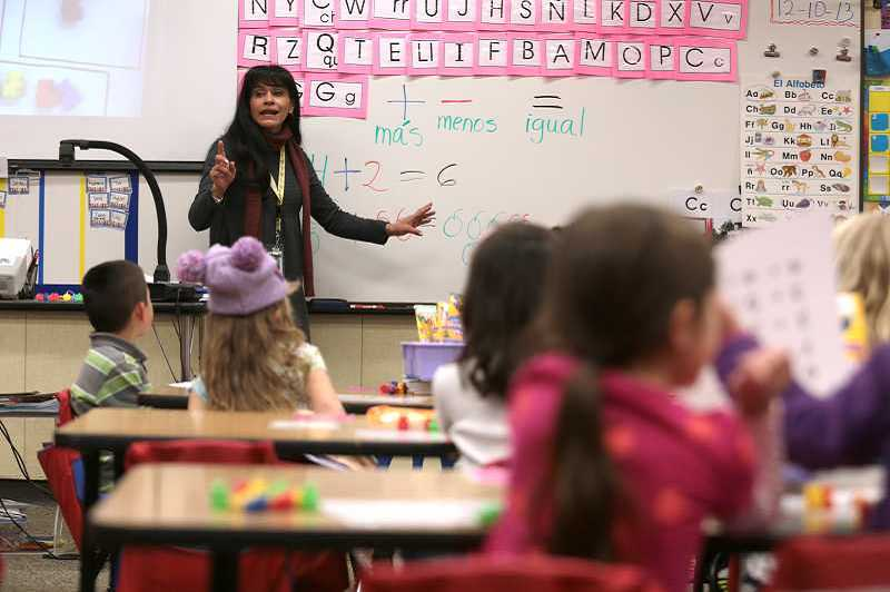 Elsa Palza-Rink goes over basic math problems during her dual-language immersion class at Bridgeport Elementary School. The district is opening up several slots in dual language courses to people who lives outside the school's boundaries.