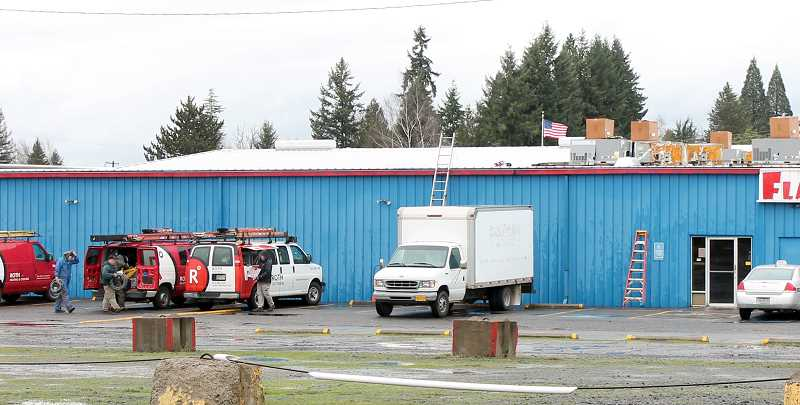 by: CORY MIMMS - Workers prepare to install new HVAC at Molalla Bowl.