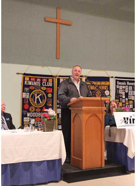 by: LINDSAY KEEFER - Randy Traeger addresses a crowd of nearly 80 guests at Woodburn United Methodist Church for the Mayor's Prayer Breakfast March 4.