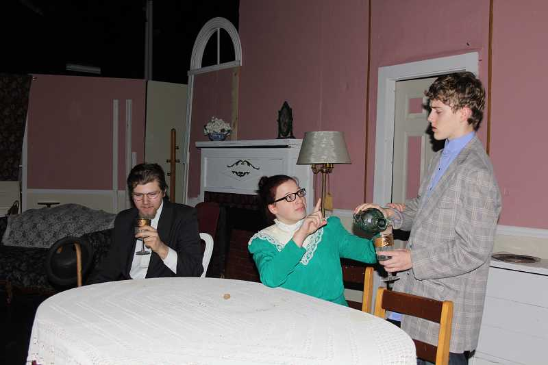 by: LINDSAY KEEFER - Martha Brewster (center), played by North Marion senior Julia Coe, warns her nephew, Mortimer (right), played by junior Skyler Younger, not to drink the elderberry wine used for her victims, like Mr. Gibbs (left), played by senior William Benson, in a rehearsal for 'Arsenic and Old Lace.'