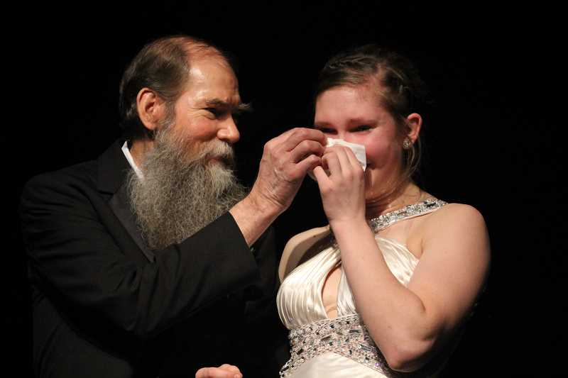 by: LINDSAY KEEFER - Milla Snegirev's father, Anfim Snegirev, hands her a tissue during the formal wear event. She would later be crowned Miss Gervais 2014.