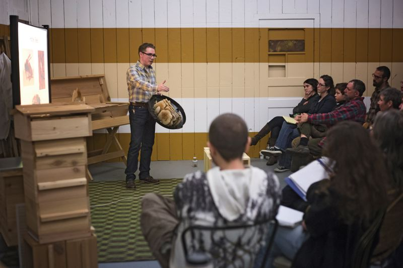 by: PAMPLIN MEDIA GROUP: JONATHAN HOUSE - Bee Thinking owner Matt Reed leads a sold-out beginners class on beekeeping at his Southeast Portland store.