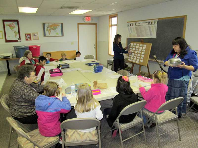 by: COURTESY PHOTO: ART HEERWAGEN - During the noon hour last Tuesday, PREP4Kids parent volunteers Cindy Schneider (left) and Roberta Perry (right) work with Dilley Elementary School students at Dilley Bible Church, located next door to the school.