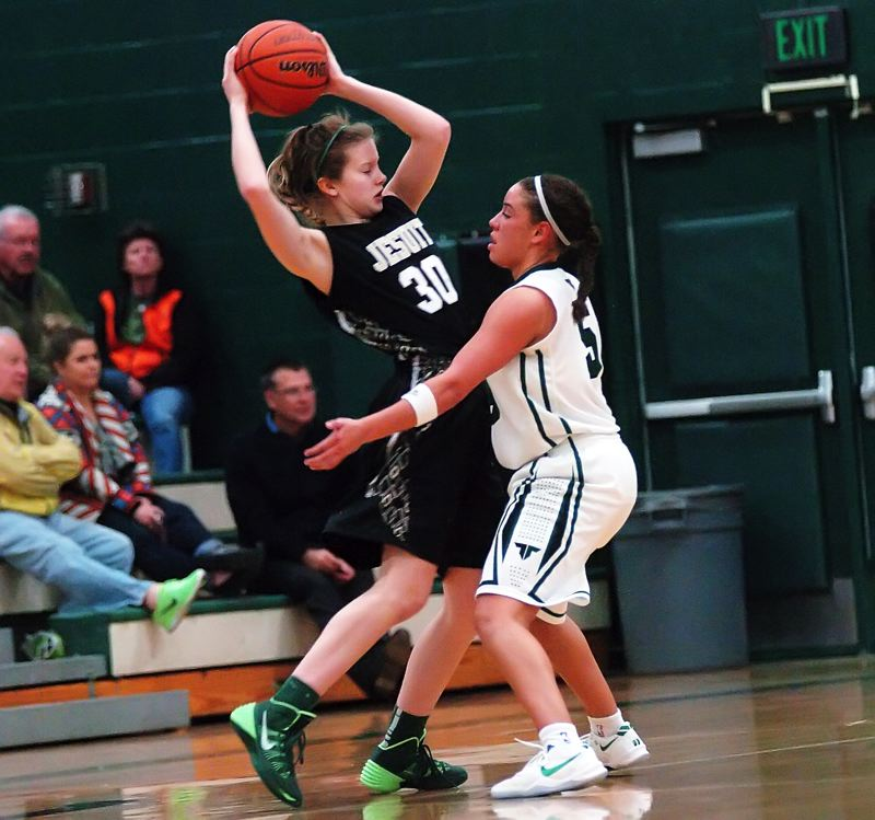 by: TIMES PHOTO: DAN BROOD - Jesuit sophomore Ellie Sears (left) is under heavy pressure from Tigard senior Lexi Carter during the Crusaders' second round loss.