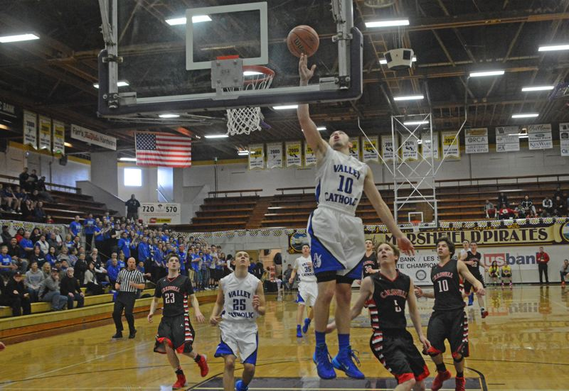 by: TIMES PHOTO: MATT SINGLEDECKER - Valley Catholic senior point guard Jarrett Gray goes up high for a right-handed finish in the first quarter of the Valiants quarterfinal win over Creswell.