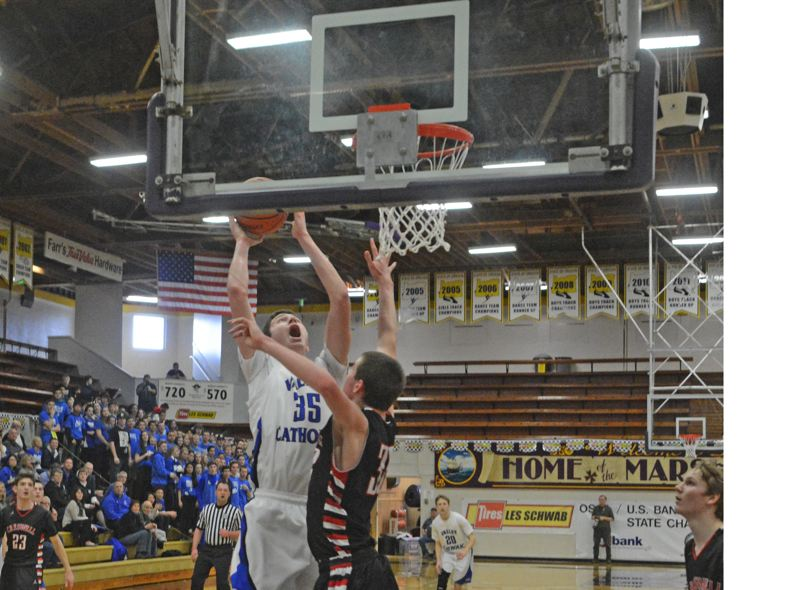 by: TIMES PHOTO: MATT SINGLEDECKER - Valley Catholic senior post Gabe Taylor scored 25 points and grabbed 15 boards against Creswell.