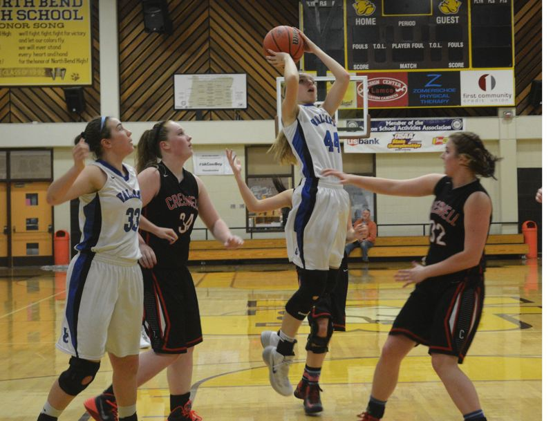 by: TIMES PHOTO: MATT SINGLEDECKER - Valley Catholic senior post Kim Duyck comes down with an offensive rebound against Creswell.