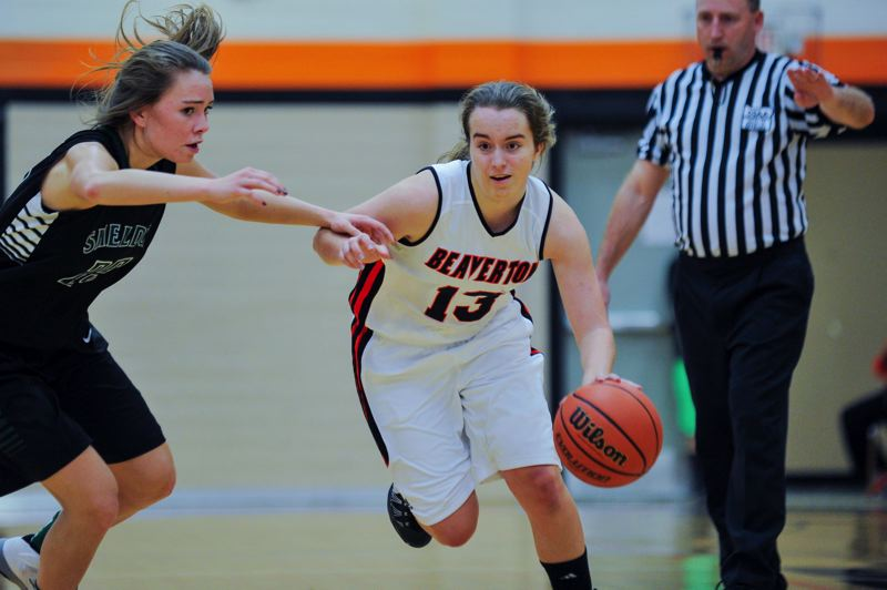 by: TIMES PHOTO: JOHN LARIVIERE - Alyssa Christiansen (right) of Beaverton drives against Karina Clark (left) of Sheldon during the third quarter.