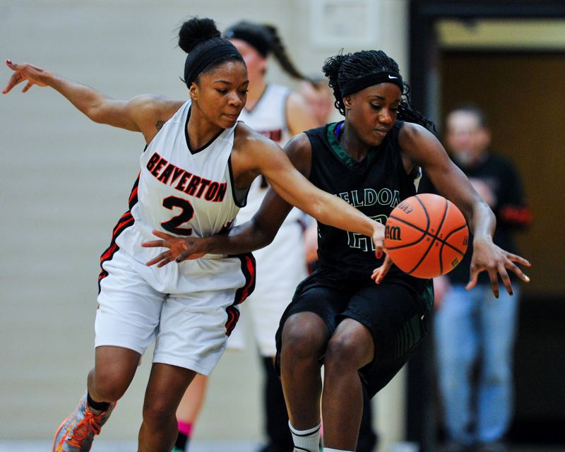 by: TIMES PHOTO: JOHN LARIVIERE - Danielle Hartzog (left) of Beaverton steals the ball from Belle Diouf (right) of Sheldon in the first quarter.