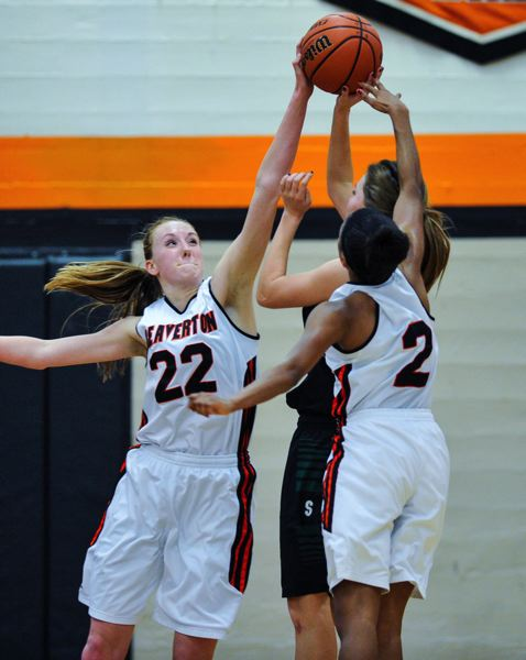 by: TIMES PHOTO: JOHN LARIVIERE - Dagny McConnell (left) of Beaverton blocks the shot of Sheldons Karina Clark (center) as Danielle Hartzog (right) also defends.