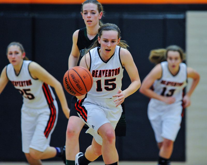 by: TIMES PHOTO: JOHN LARIVIERE - Allison Mueller of Beaverton leads a fast break down the floor.