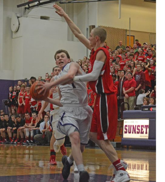 by: TIMES PHOTO: MATT SINGLEDECKER - Sunset senior guard Glenn Tanguy came up big for the Apollos against McMinnville, scoring 18 points to help send Sunset to the state tournament.