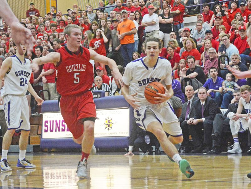 by: TIMES PHOTO: MATT SINGLEDECKER - Sunset senior guard Mikey Fey makes his way into the lane against McMinnville in the second round of the 6A playoffs on Saturday.
