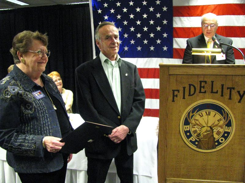 by: OUTLOOK PHOTO: BEVERLY CORBELL - Presenting the award for Gresham Elks Elk of the Year award to Lef Hofer, center, were last years recipient Betty Chisum, left, and Exalterd Ruler Jim Hosmer.