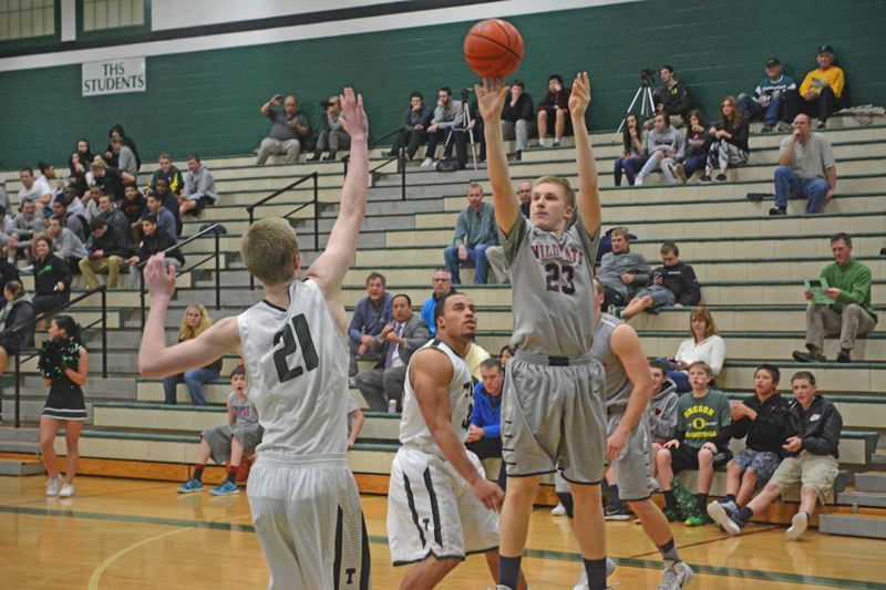 by: TIMES PHOTO: MATT SINGLEDECKER - Westview junior forward Bryce Johnson puts up a jumper against Tigard. Johnson led the Wildcats in scoring and grabbed four rebounds