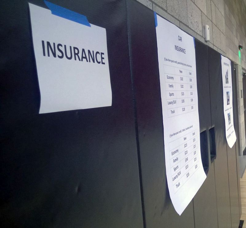 by: POST PHOTO: KYLIE WRAY - Booths around the gym displayed monthly payment options for insurance, groceries, rent and childcare.