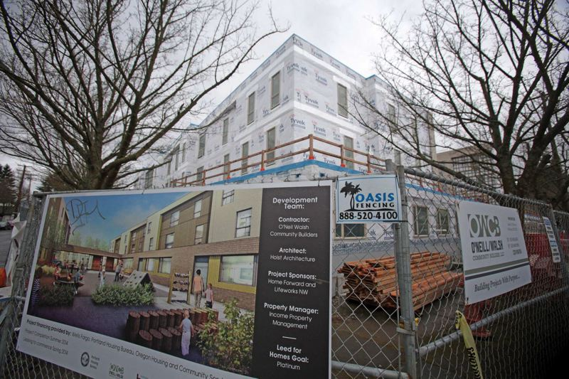 by: TRIBUNE PHOTO: JONATHAN HOUSE - This regulated housing project under construction in Northeast Portland is going to be reserved for people in residential treatment programs.