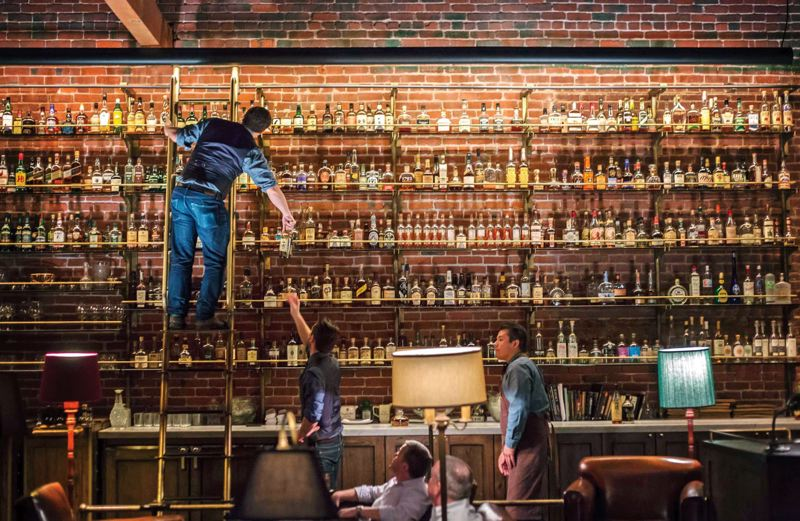 by: TRIBUNE PHOTO: JONATHAN HOUSE - One of the most striking visuals in the very popular Multnomah Whiskey Library is the vast collection of libations.