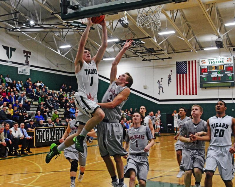 by: MATT SINGLEDECKER - SOARING -- Tigard senior point guard Bryan Berg (1) goes up to the basket against Westview's David Coffey in the second quarter of the Tigers' first round playoff win over the Wildcats.