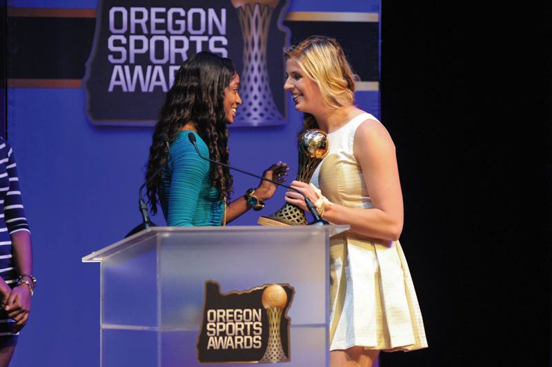 by: COURTESY OF JOHN LARIVIERE - Haley Crouser (right), from Gresham High and now a freshman at the University of Oregon, collects her trophy as prep girls track and field athlete of the year for 2013 from former UO sprint star English Gardner.
