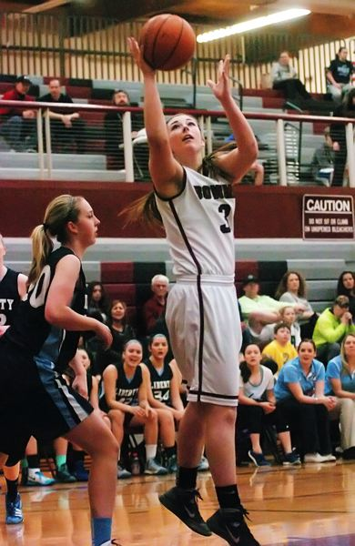 by: DAN BROOD - STAYING STRONG -- Sherwood senior Jaelyn Funk, showed here in game played earlier this season, had a big game on defense and hit some key free throws in the win at Marist.