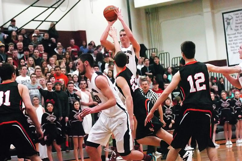 by: DAN BROOD - FROM LONG RANGE -- Sherwood senior Lucas Johnson takes a jump shot over a crowd of players during the Bowmen's state playoff win over Silverton.
