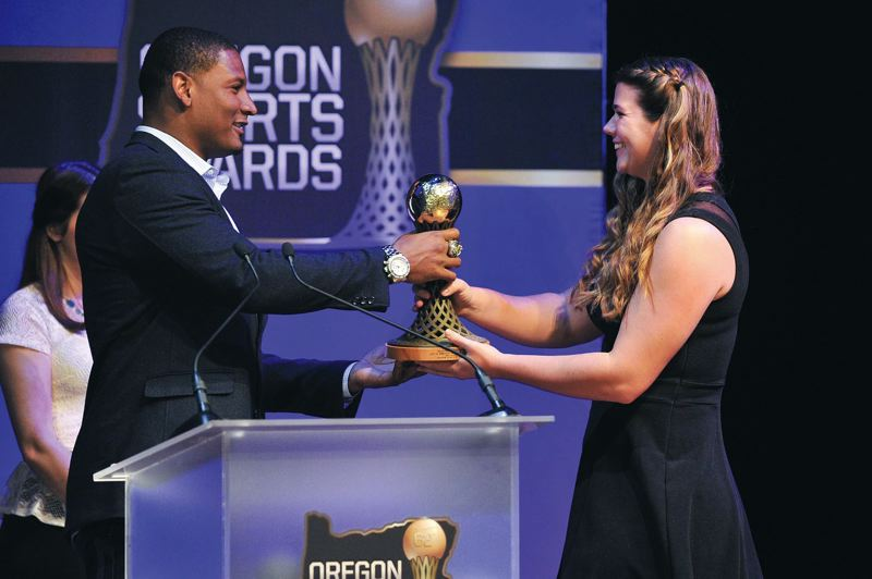 by: COURTESY OF JOHN LARIVIERE - Liz Brenner (right), multisport Oregon Ducks star, is honored as the 2013 Bill Hayward Female Amateur Athlete of the Year. Baltimore Ravens tight end Ed Dickson, also from UO, presents her with the trophy at the Oregon Sports Awards.