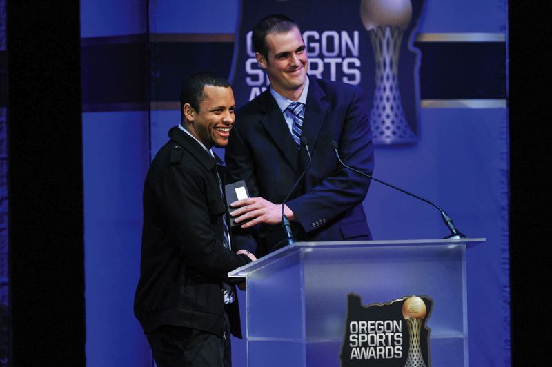by: COURTESY OF JOHN LARIVIERE - Keanon Lowe (left) of the Oregon Ducks and Sean Mannion of the rival Oregon State Beavers agree to shake hands before the present trophies at the Oregon Sports Awards Sunday at Nikes Tiger Woods Center.