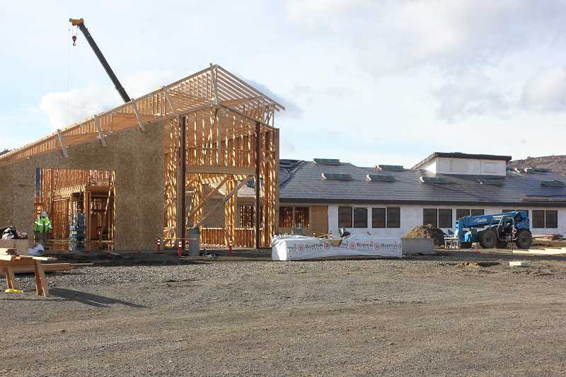 by: SUSAN MATHENY - Construction workers are making progress on the Warm Springs K-8 Academy, which will open its doors for the 2014-15 school year.