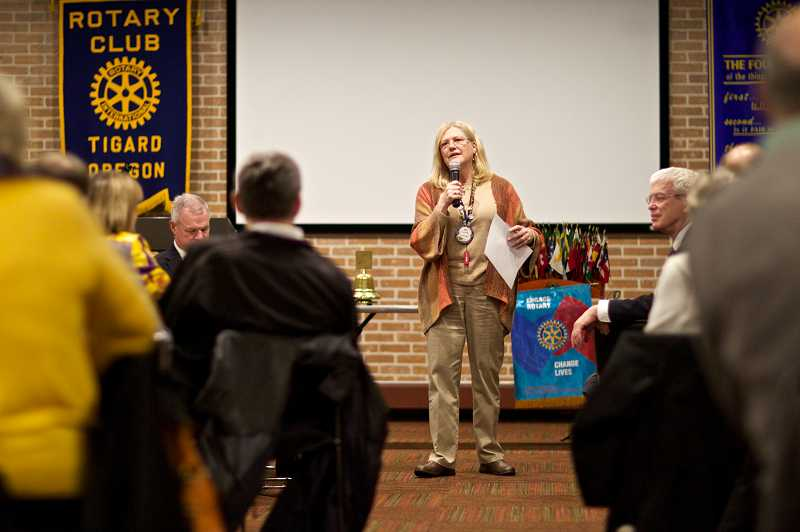by: TIMES PHOTO: JAIME VALDEZ - Tigard Rotary President Judy Miller talks to Rotarians at the groups regular meeting at Nicolis Grill & Sports Bar last week. The club celebrates its 50th anniversary this year.
