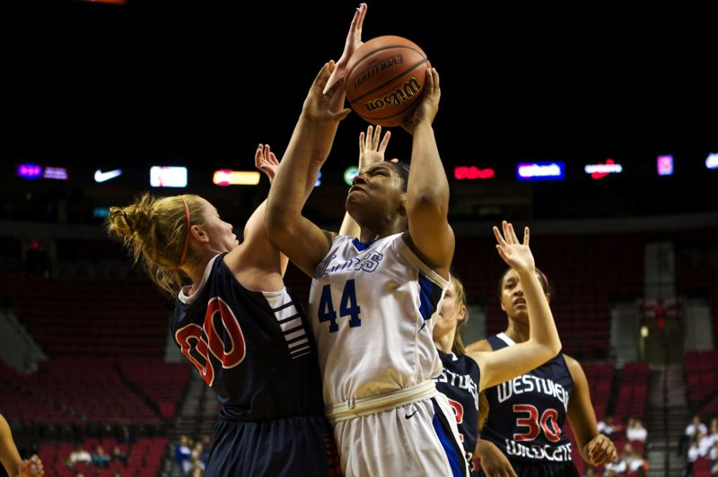 by: TRIBUNE PHOTO: JAIME VALDEZ - St. Mary's Academy's Tyschal Blake shoots against Westview's Dana Bentz in the first half of their state quarterfinal.