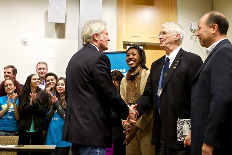 by: TIMES PHOTO: JAIME VALDEZ - Gov. John Kitzhaber shakes hands with Portland Community College board member Jim Harper as Kali Thorne Ladd looks on. Kitzhaber stopped by the Rock Creek campus on Tuesday to sign to bills boosting higher education initiatives.