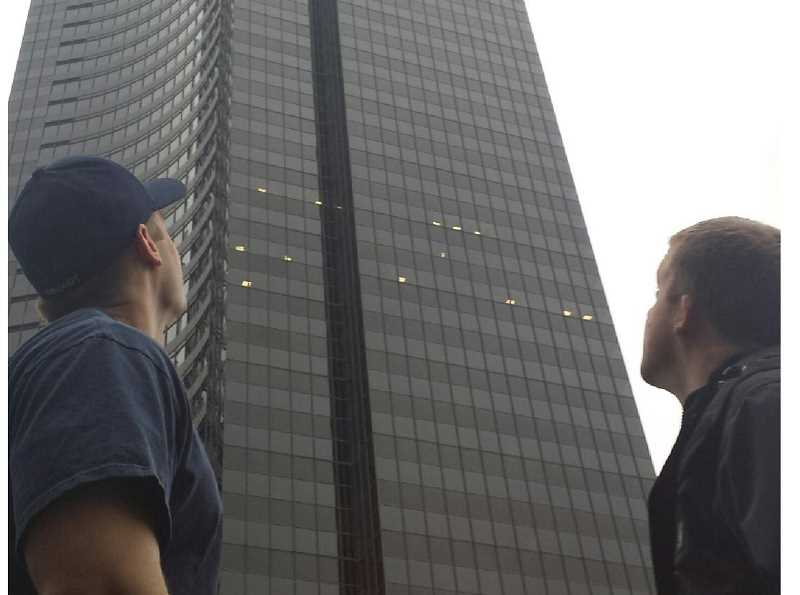by: SETH TOOLEY, CCFR - Local firefighter Russ Deboodt (LEFT) and crew mate Chris Anderson size up the Columbia Tower in Seattle. Deboodt climbed 69 flights of stairs inside the skyscraper as part of a fundraiser.