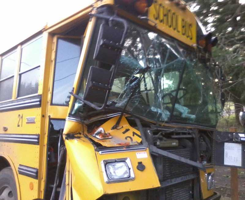 by: SUBMITTED PHOTO - Students had to be evacuated out of the back of this Colton school bus following a crash Thursday morning.