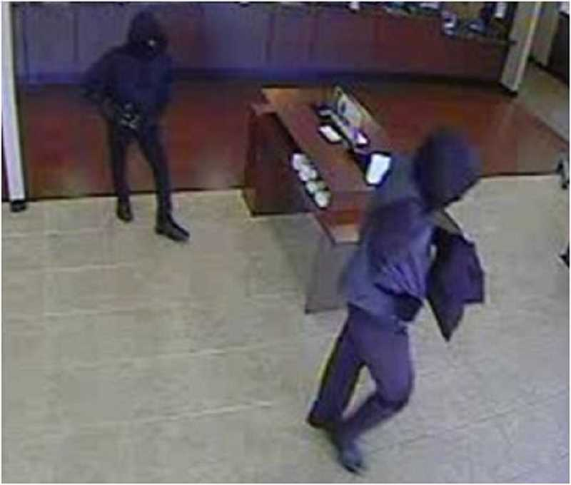 Witnesses describe both men as having dark complexions. One man was about 5 feet 11 inches with a medium build. He was wearing a black or dark-colored hoodie. The second man was about 5 feet 9 inches and very thin. He was wearing a hoodie that was black and bluish/gray. Both men were wearing what may be neoprene-style face masks.