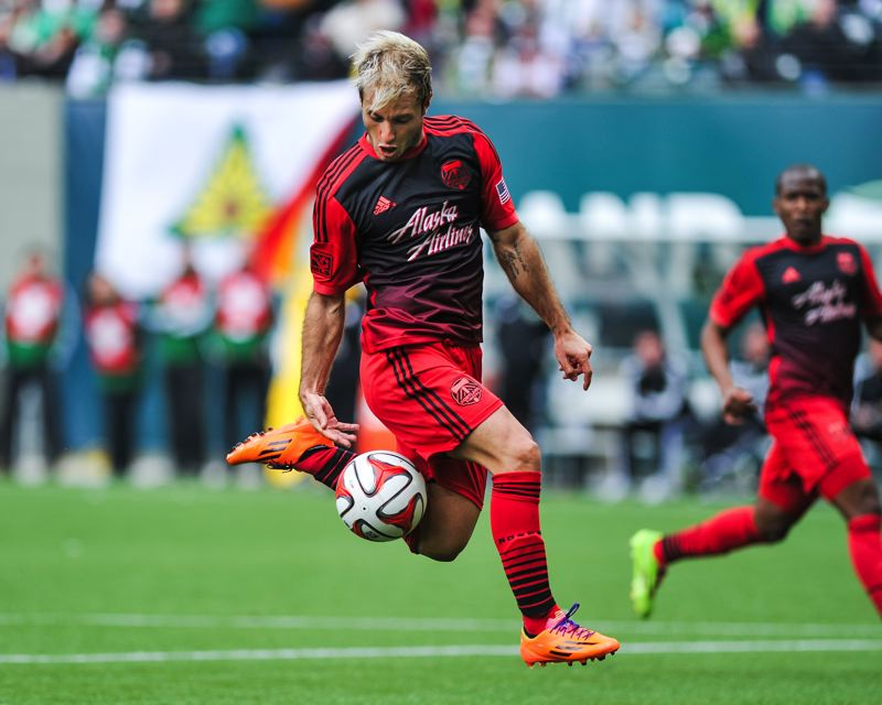 by: COURTESY OF JOHN LARIVIERE - Gaston Fernandez collects the ball in the attacking third in the Portland Timbers' 1-1 draw Sunday with the visiting Chicago Fire.
