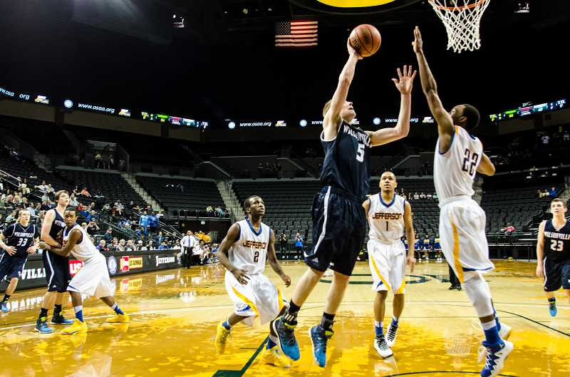 by: GREG ARTMAN - Sophomore wing Tyler Hieb goes up for a close-range shot March 13 during the Wilsonville boys basketball team's quarterfinal game against Portland-Jefferson. The Wildcats finished the tournament in sixth place.