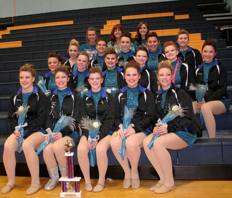 by: TERESA TOOLEY/CENTRAL OREGONIAN - The Sparkles pose with a trophy they won at a competition earlier this year. The team will comp;ete in the state championships beginning Friday and continuing through Saturday evening at Veterans Memorial Coliseum in Portland.