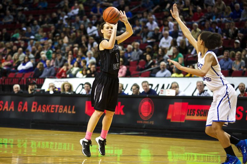 by: JAIME VALDEZ - Oregon City senior Jessica Gertz launches a 3-pointer in Saturday nights championship game with top-ranked South Medford.